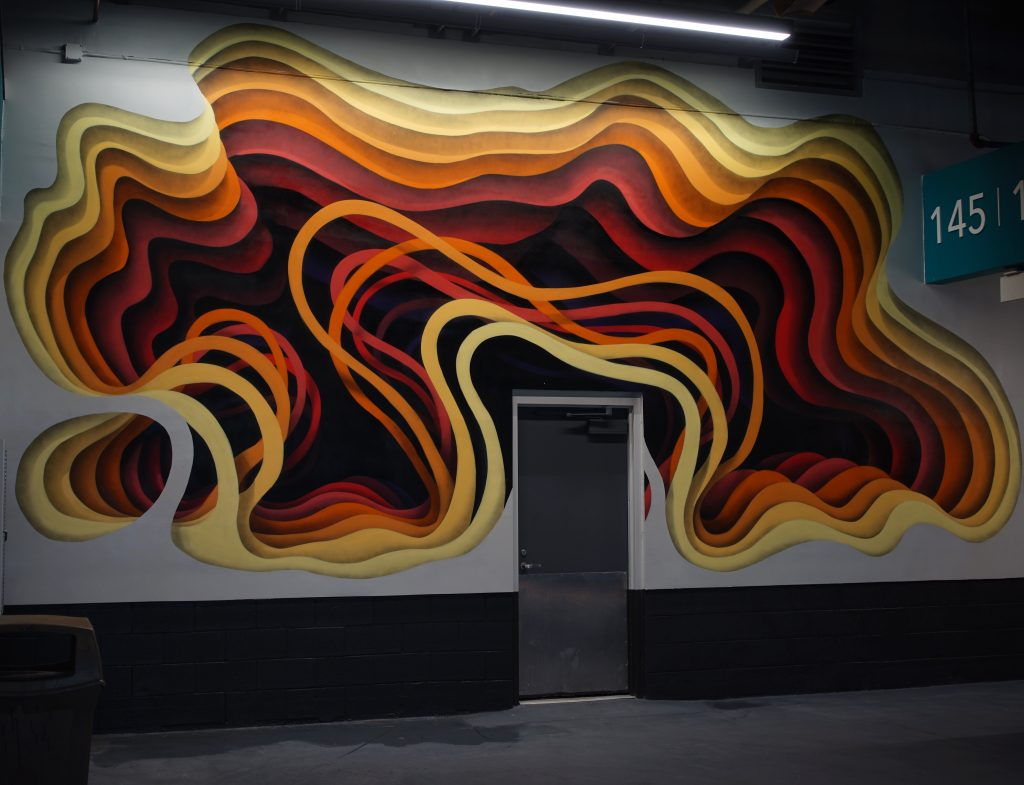 Street artists paint the walls of the new Miami Dolphins stadium