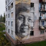 Guido van Helten paints a mural in Ukrainian conflict zone