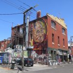 Adnate paints the Dalai Lama in Melbourne