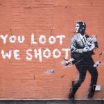 """You Loot, We Shoot"" by Banksy in New York City"