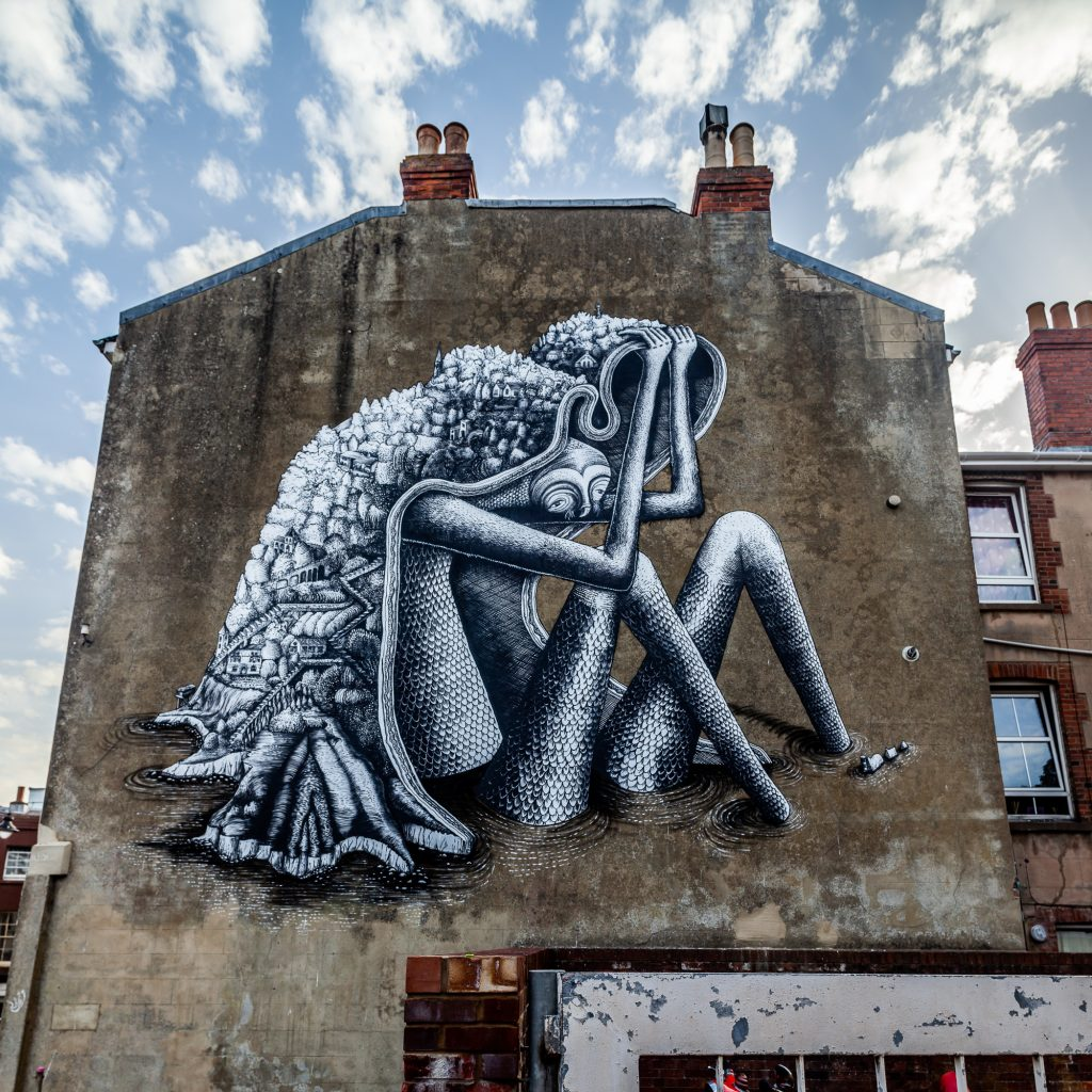 Phlegm creates a new piece at the southern tip of the Isle of Wight