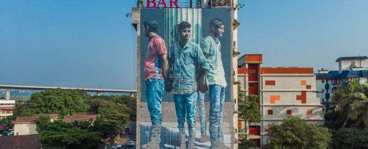 """Four Men Holding Roman column"" by Fintan Magee in Goa, India"