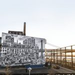 JR Unveils Massive Outdoor Mural In Domino Park, His Largest To Date In Ny