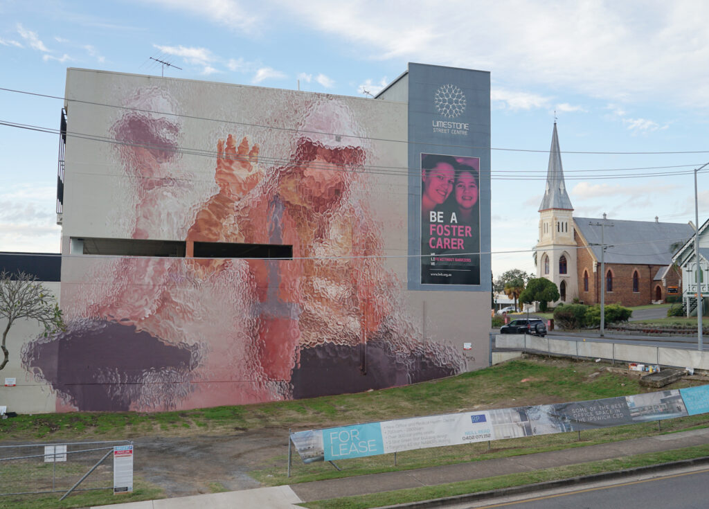 """""""Two Figures Behind Glass"""" by Fintan Magee in Ipswich, Australia"""