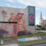 """Two Figures Behind Glass"" by Fintan Magee in Ipswich, Australia"