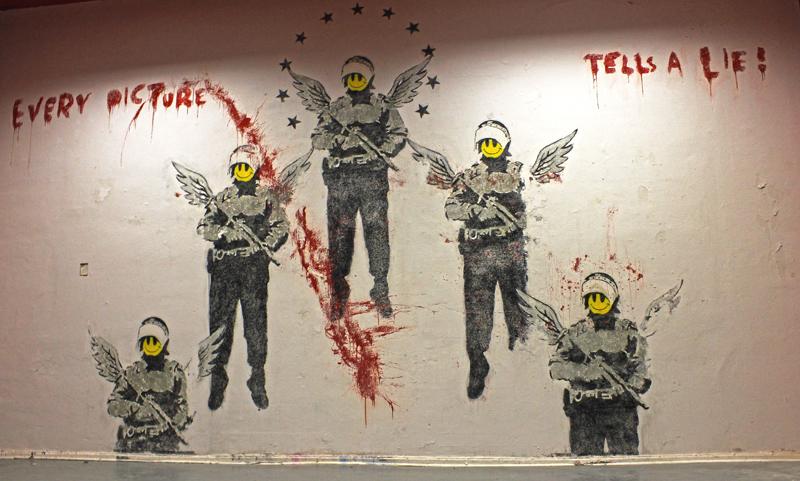 Descobrindo Banksy – Parte 4 Artes & contextos Every Picture Tells A Lie Berlin 2003